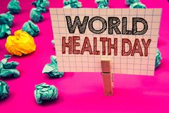 Writing note showing World Health Day. Business photo showcasing Special Date for Healthy Activities Care Prevention Clothespin h stock images