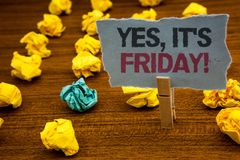 Writing note showing Yes, It 'S Friday Motivational Call. Business photo showcasing having weekend Taking rest break Cardboard wit. H letters wooden floor fuzzy stock image