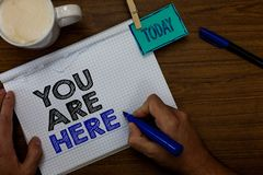 Writing note showing You Are Here. Business photo showcasing This is your location reference point global positioning system Hand royalty free stock image
