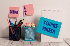 Writing note showing You Re Fired. Business photo showcasing Used by boss indicate employee that he is discharged from. Writing note showing You Re Fired stock image