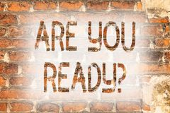 Writing note showing Are You Readyquestion. Business photo showcasing Be Prepared Motivated Warned Readiness Aware Brick Wall art. Like Graffiti motivational royalty free stock images