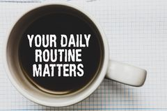 Writing note showing Your Daily Routine Matters.. Business photo showcasing Have good habits to live a healthy life Coffee mug wit. H black coffee floating some stock photos