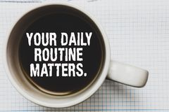 Writing note showing Your Daily Routine Matters. Business photo showcasing Have good habits to live a healthy life Coffee mug with. Black coffee floating some royalty free stock photography