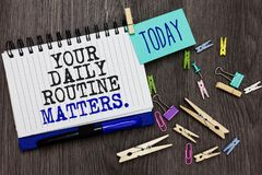 Writing note showing Your Daily Routine Matters. Business photo showcasing Have good habits to live a healthy life Different paper. Clip on woody table pinch on royalty free stock photos