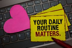 Writing note showing Your Daily Routine Matters. Business photo showcasing Have good habits to live a healthy life Red bordered ye. Llow written paper pinch with royalty free stock image