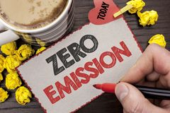 Writing note showing  Zero Emission. Business photo showcasing Engine Motor Energy Source that emits no waste products written Man. Holding Marker Cardboard Stock Photography