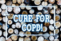 Writing note showingCure For Copd. Business photo showcasing Medical treatment over Chronic Obstructive Pulmonary. Disease Wooden background vintage wood wild royalty free stock image