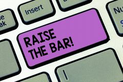 Writing note showingRaise The Bar. Business photo showcasing Set higher standards challenges seeking for excellence. Keyboard key Intention to create computer stock photos