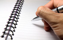 Writing On A Notebook Royalty Free Stock Photos