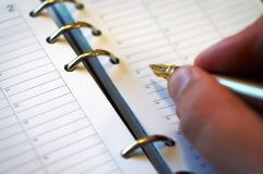 Writing notebook. Writing stuff to notebook or calendar Royalty Free Stock Image