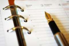 Writing notebook. Writing stuff to notebook or calendar Royalty Free Stock Images