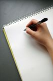 Writing on notepad. Person writing notes on an empty sketchpad stock photos