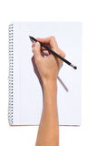 Writing On A Notepad Royalty Free Stock Photo