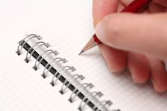 Writing on notepad Royalty Free Stock Image
