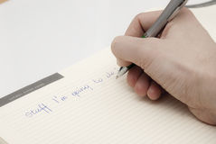 Writing in notepad what i am going to do Royalty Free Stock Photos
