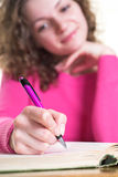 Writing notes. Attractive woman is dreaming about her future Stock Image