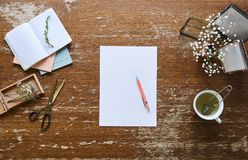Writing notes in a individual and creative workspace. Charming desktop vintage flair stock image