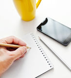 Writing notes or planning Stock Image