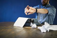 Writing Novel. Portrait of unrecognizable writer stretching hands using old typewriter, copy space stock photo