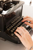 Writing with old black typewriter Royalty Free Stock Image