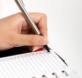 Writing on an organizer Royalty Free Stock Image