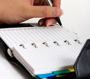 Writing on an organizer Stock Photo