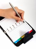 Writing on an organizer Stock Photography
