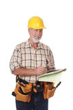 Writing out an estimate. Senior construction worker writing out an estimate for a client stock image