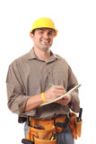 Writing out plans. Standing architect builder writing out work details Stock Photo