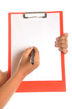 Writing pad. Businessman hands showing letter pad with pen Stock Image