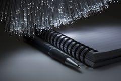 Writing pad. And pen and optical fiber floodlight Stock Photos