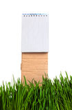 Writing Pad in the Grass Royalty Free Stock Photo