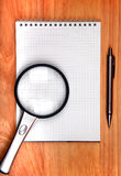 Writing Pad And Loupe Stock Photo