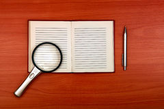 Writing Pad and Loupe Stock Image