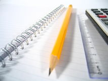 Writing Pad With Pencil I. A writing pad with a ruler, a pencil and a calculator Royalty Free Stock Photos