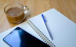 Writing pad with pencil Stock Photos