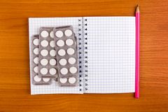Notepad with a Pills stock photo