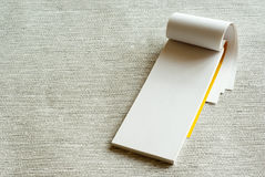 Writing pad. White writing pad on grey background Stock Images