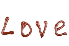 Writing and painting with chocolate - love Stock Photo