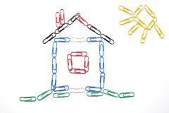 Writing paper clips. Figure of a small house laid out from writing paper clips Stock Images