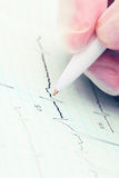 Writing on paper ECG. Royalty Free Stock Photography