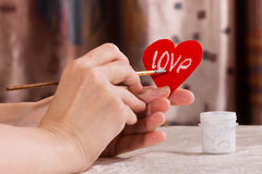 Writing on the paper heart for Valentine's day Stock Photography