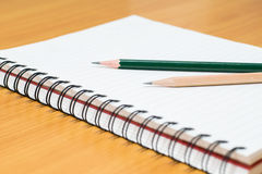 Writing on paper. Pencil and notebook preparing for writing Stock Photo