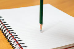 Writing on paper. Pencil and notebook preparing for writing Stock Images