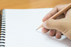 Writing on paper. Pencil and notebook preparing for writing Royalty Free Stock Image