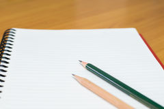 Writing on paper. Pencil and notebook preparing for writing Royalty Free Stock Photos