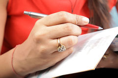 Writing with a pen Royalty Free Stock Image
