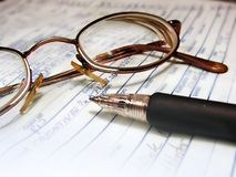 Writing: pen and glasses. Writing concept: pen and glasses royalty free stock photography