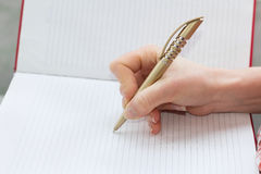 Writing with a pen Royalty Free Stock Photo