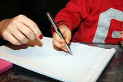 Writing with pen Stock Photography
